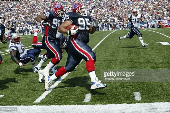 Sam Adams TD against NE in week 1, 2003. Credit Damian Strohmeyer, Getty Images